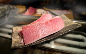 cutting of otoro from blue fin tuna for sashimi.
